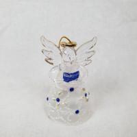 Angel v darilni embalaži, pike, modra knjiga v rokah